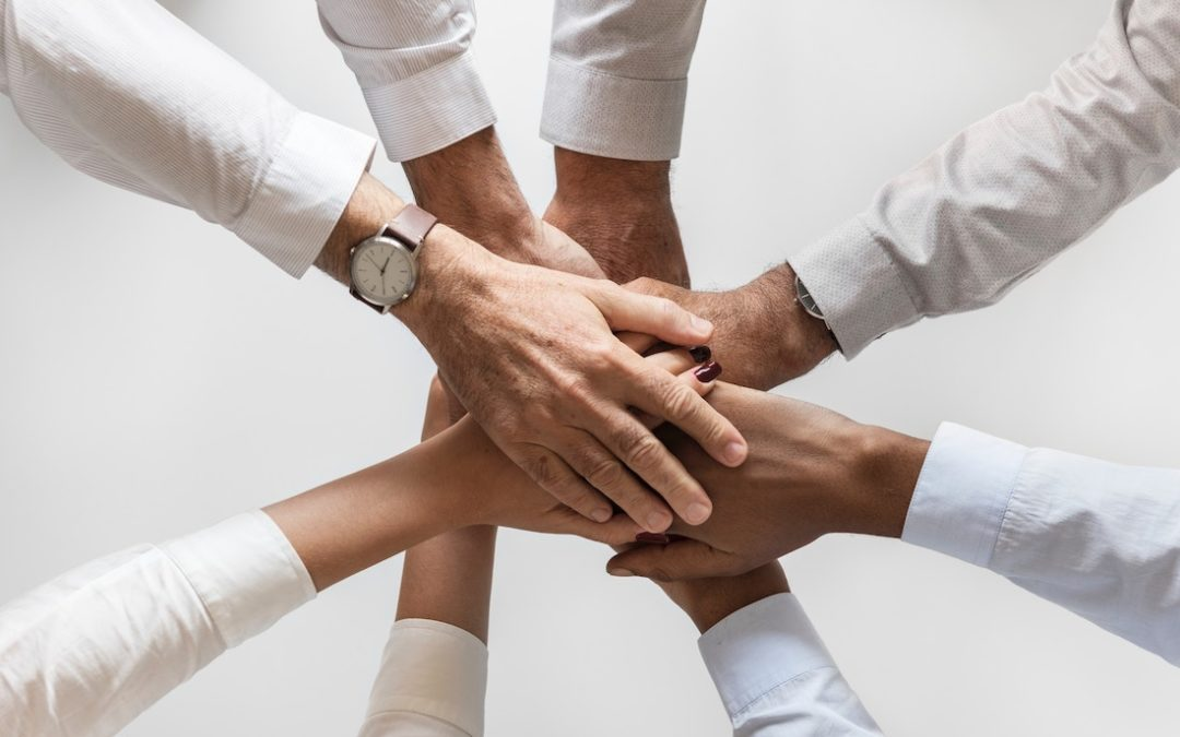 wellness culture hands together in a huddle