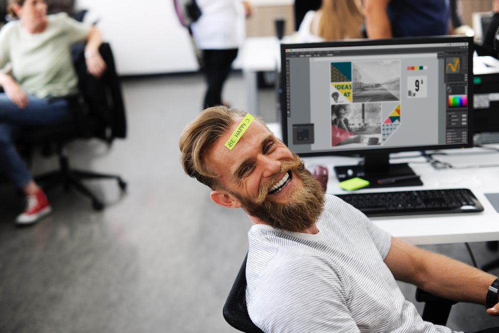 employee retention smiling man with be happy sticky note on forehead eric hipple